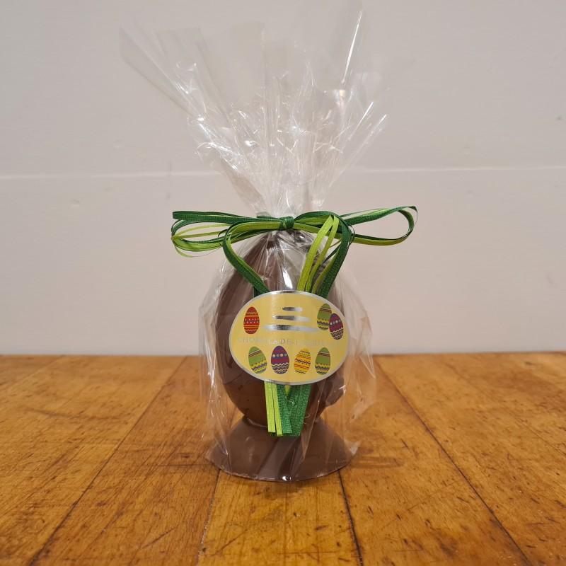 Hel påskeæg i lys chokolade, ca. 10 cm. DENNE VARE SKAL AFHENTES I BUTIKKEN